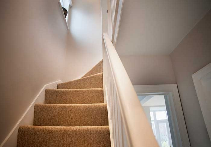 beige carpet on stairs
